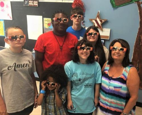 Ms. Terri's class tries on glasses